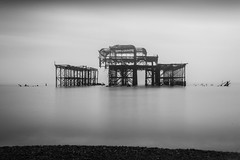 Brighton's West Pier (jonathanpeterss) Tags: ocean lighting old longexposure morning travel light sea sky blackandwhite white mist black west beach halloween water misty fog clouds composition contrast photoshop sunrise dark photography pier early blackwhite frames high scenery brighton long exposure scaffolding shadows westsussex cloudy stones centre foggy highcontrast overcast center pebbles tourist highlights symmetry spooky filter nd slowshutter symmetrical rusting remains edit highpass lightroom deteriorating ndfilter brightonwestpier foggywater nd1000 mistywater brightonsoldpier