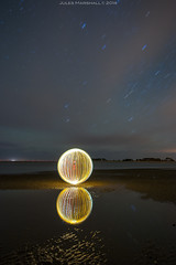 reflected(8) (~ jules ~) Tags: longexposure blue red sea sky orange lightpainting reflection beach night clouds ball stars globe julian nikon orb 8 tokina sphere round jules wellsnextthesea lightpaint lightorb 1116mm d300s julianmarshall julianmarshall2014