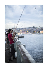catch of the day (jrockar) Tags: street travel boy portrait 3 man blur guy field canon turkey lens photography 50mm prime fishing fisherman dof shot mark f14 iii 14 streetphotography documentary istanbul snap pole instant catch 5d mm hook moment standard 50 depth ef mk 2014 5014