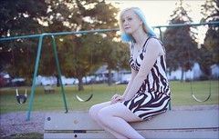 Athena - Park (rbatina) Tags: rubbertoe amateur model modeling pose posing pretty young woman cute pale teen white girl beautiful bare skin teenage blond blonde hair blue highlights thin little petite dress skirt mini miniskirt outside outdoors park eyes nose mouth lips face arms shoulders legs cleavage zebra striped revealing outfit print hot chest necklace jewelry makeup hips waist october 16 16th 2016 playground curvy tight clothes bench