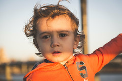 Shaded eyes. (Pablin79) Tags: portrait boy sunset people wind light youth cute happiness child colors fun kid little childhood one closeup outdoors daylight afternoon argentina enjoyment vicente misiones facialexpression vini eyescontact posadas
