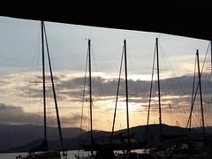 Sun and sails down... (alekathom) Tags: sky sunset sailboat volos greece clounds outdoor blue