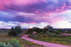 Nambe, New Mexico ([ raymond ]) Tags: img7556 clouds desert nambe newmexico pink purple road southwest storm sunset landscape