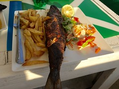 "Mukeke for lunch: the traditional freshwater fish of Burundi.  Bora Bora beach. Bujumbura. Burundi  August 2016 #itravelanddance • <a style=""font-size:0.8em;"" href=""http://www.flickr.com/photos/147943715@N05/30438126266/"" target=""_blank"">View on Flickr</a>"