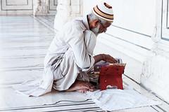White Prayer (Riccardo Maria Mantero) Tags: riccardomantero riccardomariamantero delhi india muslim newdelhi outdoors people reading religion study travel