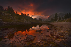 Portal (Radisa Zivkovic) Tags: lake mountain sunset travel dolomites italy alps tyrol rock stone reflection tree shore red cloud dramatic highland woods landscape nature scenery outdoor beautiful wilderness moody environment water