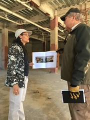 Inspector General John F. Sopko touring unfinished hotel and residences project with SIGAR engineer