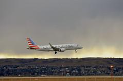 American Eagle N227NN (V1 Aviation Photography) Tags: calgaryinternationalairport cyyc yyc envoy americaneagle embraer n227nn erj175lr erj170200lr e175