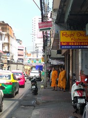 Monks contemplating crossing the street - Bangkok (ashabot) Tags: bangkok thailand traveltips streetscenes street buddhistmonks monk monks buddhism travel citystreets streetlife