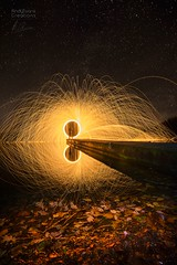 Fired Up (aevo69) Tags: andy evans andyevanscreations fire sparks wire wool spinning spun up night photography jetty long exposure water reflection stars sky reflections