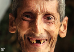 Syria will always smile through the pain. (Take a look on Syria without propaganda) Tags: hunger syria assad poor poverty siege south damascus smile hardship old eldery city russia massacre hope man humanity human rights silence criminal crime portrait flickr
