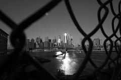 2041 (Panda1339) Tags: 28mm usa summiluxq monochrome nyc leicaq streetphotography worldtradecenter sunrise blackandwhite architecture fence