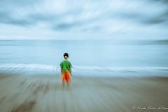 dragged into the sea (reiernilsen) Tags: ocean boy sea sky motion blur beach canon 7d tenerife reiernilsen