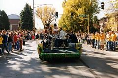 A band playing in the homecoming parade down University Dr., circa 1990s. (NDSU University Archives) Tags: parades bands homecoming floats northdakotastateuniversity