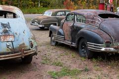 Mason Motors (gtkenji) Tags: old autumn chevrolet abandoned car truck junk rust vintagecar michigan fallcolors rusty fallfoliage weathered derelict desoto gaspump keweenaw vintagetruck masonmotors