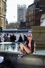 How to use a Reflector (ColinB Portraits) Tags: street pink woman cute london water fountain girl hat female outside photography glasses model sitting legs candid relaxing streetphotography trafalgarsquare posing streetscene sneakers trainers reality shorts colourful reflector squatting candidphotography inpublic streetcandids londonview colinb londonscene londoncandid casualstreetcandid