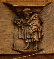 Breda, Noord-Brabant, Grote Kerk, choir, main stalls, south side, inner row, misericord (groenling) Tags: wood man netherlands choir expression nederland carving nl breda grotekerk stalls hout woodcarving patten noordbrabant