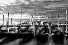 Venice bw1 (photoautomotive) Tags: longexposure venice italy water canon buildings boats europe gondola posts gondolas 1740l cannel 50d