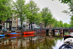 Herengracht Canal. Amsterdam (Albert Jafar) Tags: holland netherlands amsterdam boat canal redboat springinamsterdam herengrachtcanal earlymorninginherengrahct