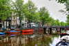 Herengracht Canal. Amsterdam (Albert Jafar) Tags: holland netherlands amsterdam boat canal bicycles canalhouses redboat grachtenpand springinamsterdam herengrachtcanal earlymorninginherengrahct