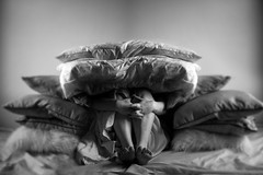 When It's Safe To Come Out (Corah Louise Photography) Tags: life portrait blackandwhite bw white black feet up foot photo bed university child adult legs leg picture surreal pic portraiture uni growing safe cushions imahe concetual