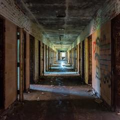 Burwash Cells (Gregory Pleau) Tags: light shadow ontario canada brick abandoned graffiti hall decay ruin cell tunnel hallway prison jail shadowplay cells gaol correction burwash sudburyunorganizednorthpart