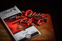 Hot excellence (Jarek Jahl) Tags: chili peppers red hot spice chocolate dark lindt creative tabletop