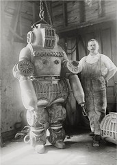 #Chester E. Macduffee standing next to his patented atmospheric diving suit that was made from aluminum alloy, weighed about 250 kilograms, and could reach a water depth of 65 meters (1911) [1600 x 2248] #history #retro #vintage #dh #HistoryPorn http://if (Histolines) Tags: histolines history timeline retro vinatage chester e macduffee standing next his patented atmospheric diving suit that was made from aluminum alloy weighed about 250 kilograms could reach water depth 65 meters 1911 1600 x 2248 vintage dh historyporn httpifttt2eqklyx