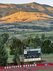 Southern Oregon (acase1968) Tags: raiders raider stadium track grizzly peak dusk siskiyou mountains ashland nikon d500 nikkor 70200mm f28g lithia butler asante rogue credit union coming attractions theatres pepsi scoreboard