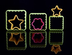Outside the Box (Karen_Chappell) Tags: green black pink yellow shape reflection three six star flower square stilllife shapes box