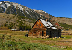 Old Shed (Aubrey Stoll) Tags: shed old wood colorado mountains snow travel grass logs hills carpentry woodwork america usa freeway privateland bluesky trees tourism hiking driving farming nature outdoors