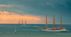 Seascape at sunset (Igor Komissarov) Tags: sochi seascape scf regata  tallship sail sunset bright color  abigfave