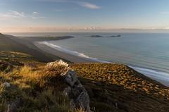 'Rhossili Sunrise Light' - Rhossili Bay (Kristofer Williams) Tags: rhossili rhossilibay sunlight heather mountainside bay beach coast wormshead landscape southwales gower