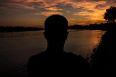 Sam basking in the dying sun (StephenChaotic) Tags: sam sambo silouhette samholdren exploring adventure sunset river sunsetting afterglow colors cloud warm