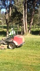 Mowing the Golf course corner (spelio) Tags: backyard golf course mower rideon mov