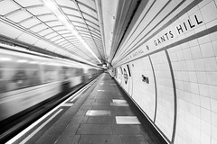 Ghost Train, Gants Hill, London (Sean Hartwell Photography) Tags: gantshill london centralline undeground londonunderground travel train trainstation speed movement motion blur platform blackandwhite monochrome empty