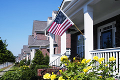 18933114136_e931533897_o (Jessica_PFP) Tags: housewithflag flag houses neighborhood patriotic home homes outside outdoors frontyard frontporch independenceday 4thofjuly residential yellowflowers lineofhouses porch residence bluesky clearbluesky
