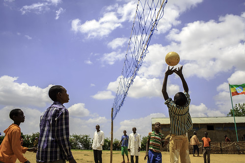 Pupils engage in the game of volleyball at Oda Aneso Primary School