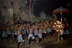 24-153 (ndpa / s. lundeen, archivist) Tags: shirtless people bali color men film festival 35mm indonesia fire lights dance candles dancers dancing torches traditional flames nick ceremony culture celebration textile fabric parasol southpacific barefoot 24 tradition 1970s 1972 indonesian candelabra balinese kecak dewolf oceania pacificislands ketjak poleng nickdewolf photographbynickdewolf groupofmen ketjack kainpoleng pacificislandculture reel24