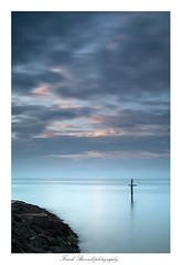 Tranquility (frank_bunnik) Tags: ocean sea france clouds sunrise rocks tranquility calm normandy calmness grandcampmaisy canontse45mm leefilters canontse bigstopper leebigstopper frankbunnik