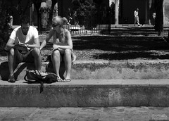 Guide book (G. Postlethwaite esq.) Tags: 2010 andalucia córdoba june spain blackandwhite candid monochrome streetscene oops peoplewatching legs thighs bare crotch upskirt pants knickers voyeur