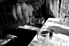 A greek way of life..--Explored November 4, 2014-- (Maria Michalinos-www.debop.gr/deBlog/the-athenians) Tags: blackandwhite bw man ice monochrome hand drink athens greece alcohol raki purealcohol tsipouro  greekway    ilobsterit