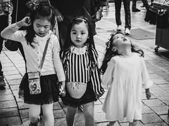 Three Dresses.jpg (Must Love Cameras) Tags: street girls white 3 black cute walking photography three holding hands pretty dress little mark sony iii adorable korea korean dresses busan m3 dong rx100 nampo iii3