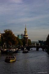 Amsterdam canal (pato_82) Tags: park city light sunset red sky cloud sun holland reflection church nature water netherlands beautiful amsterdam skyline clouds river evening daylight boat canal europe day view horizon fiume capital great tipical