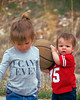 What's she want from me? (droy0521) Tags: siblings portrait candid people colordao toddlers huskers children red