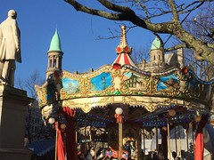 Roundabout at Belfast Christmas Market 2016 (John D McDonald) Tags: belfast belfastmarket belfastchristmasmarket belfastcontinentalmarket christmasmarket continentalmarket belfastmarket2016 belfastchristmasmarket2016 belfastcontinentalmarket2016 christmasmarket2016 continentalmarket2016 2016belfastmarket 2016belfastchristmasmarket 2016belfastcontinentalmarket 2016christmasmarket 2016continentalmarket market donegallsquare donegallsquarebelfast cityhallgrounds belfastcityhallgrounds autumn november northernireland ni ulster geotagged iphone iphone6 roundabout merrygoround statue tree architecture building branch colour colours colourful sky bluesky blue cyan turquoise yellow gold red vivid bright sunny