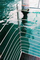 bathe in the waters of life (Exploring with Sofia) Tags: water sea seaside italy coast sun lines aesthetics blue green wood