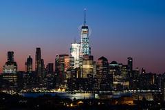 Freedom (drod31861) Tags: sky city cityscape travel blue night building tower architecture light ny moon skyline skyscrapper newyorkcity longexposure manhattan tall