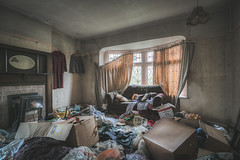 One man's junk is another man's treasure (climbing the walls) Tags: clutter livingroom emptyhouse mirror fireplace boxes junk messy festive december cold winter light unusual strange nature justoneclick oncelivedin abandonedhouse lefttodecay