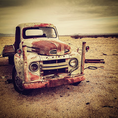 b r o k e n (Maureen Bond) Tags: ca maureenbond desert junkyard rusty crusty desolate cloudy ford truck brokenglass sandy